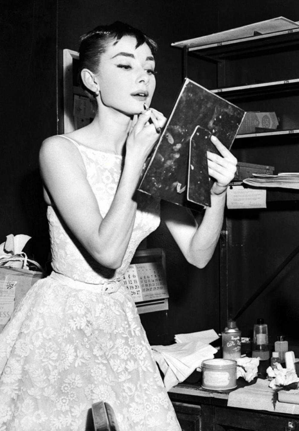 Audrey Hepburn Putting on Makeup