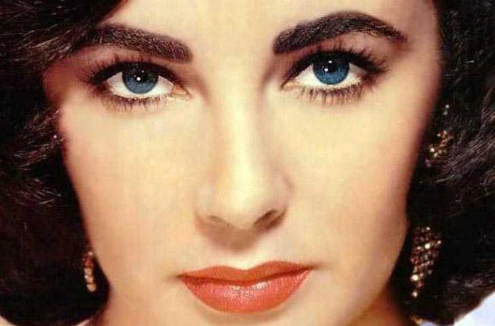 Elizabeth Taylor eye color is blue