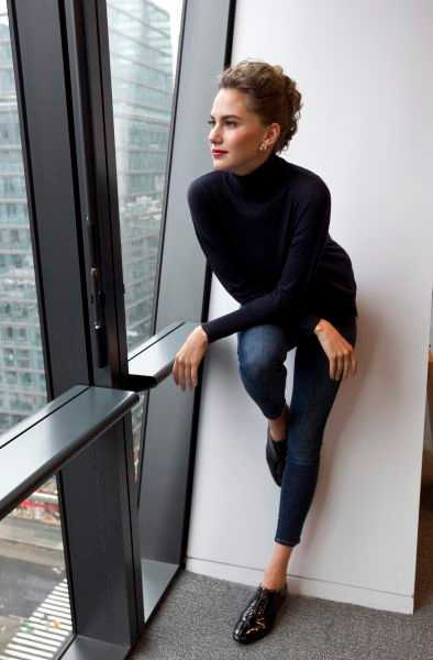 Emma Ferrer Looking out Window