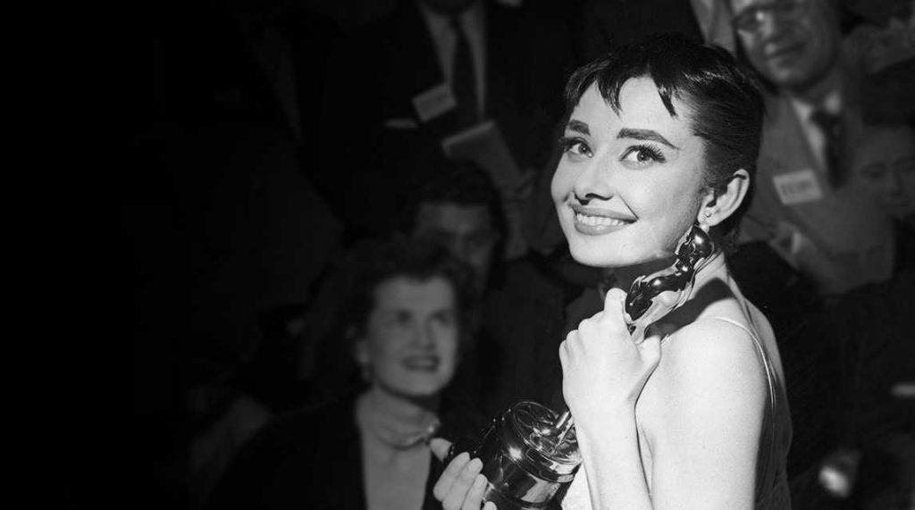 Audrey Hepburn Oscar Holding Trophy